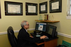 Dr Daniel Bendetowicz at his desk in Ft Myers FL